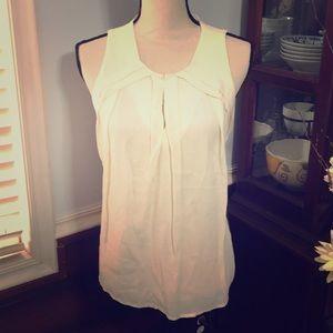 Off White sleeveless blouse, NWT